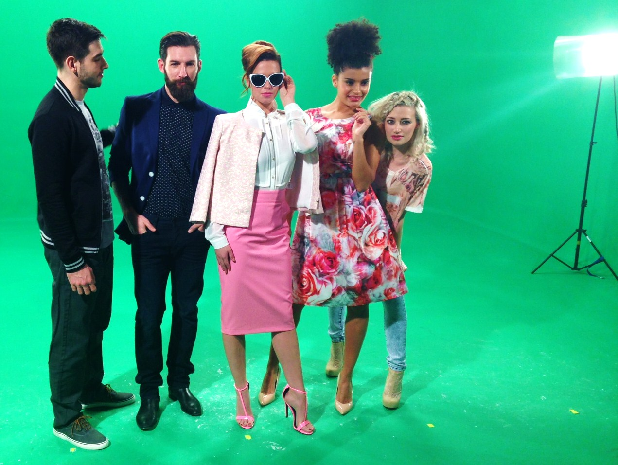 There are five models in the above picture, they are shown posing against a green screen wearing the latest spring summer fashion trends.