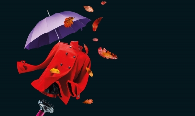 Autumn Fashion Fix event campaign logo shows fashion and beauty icons to suggest the autumn season. A red coat and autumn leaves blowi in the wind created by a hairdryer and there is a purple umbrella in the background.