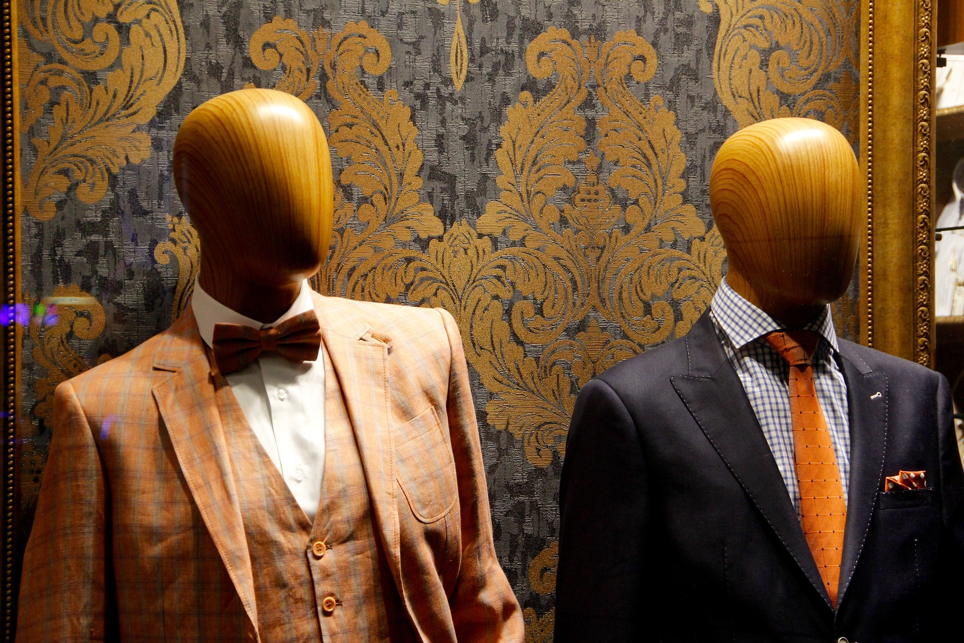 Do Men Hate Shopping. Maynineteen blog post. Image of two traditional wooden male mannequins dressed in elegant and well-tailored suits