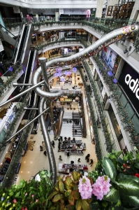 Retail-tainment - View from the 5th floor of the Printemps shopping centre, Shanghai, showing the giant stainless steel slide that delivers customers to the ground floor in 16 seconds.