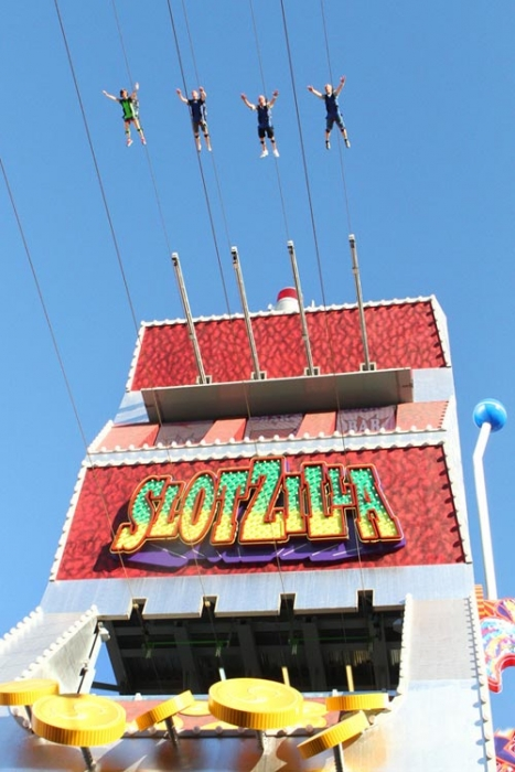 Retail-tainment - Four people riding the Slotzilla zipline above Fremont Street, a retail shopping and entertainment area of Las Vegas.